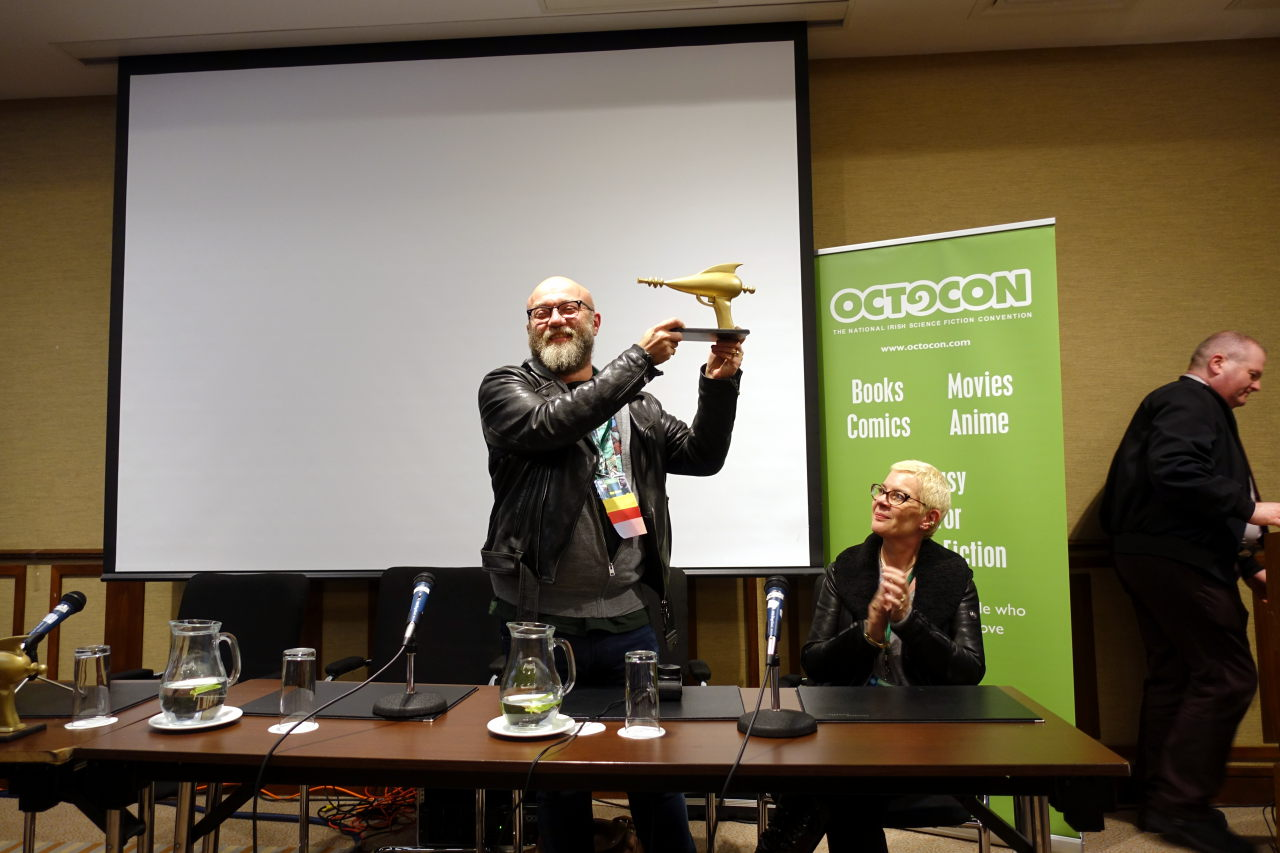 Dan Abnett receiving Golden Blasters Creative Award