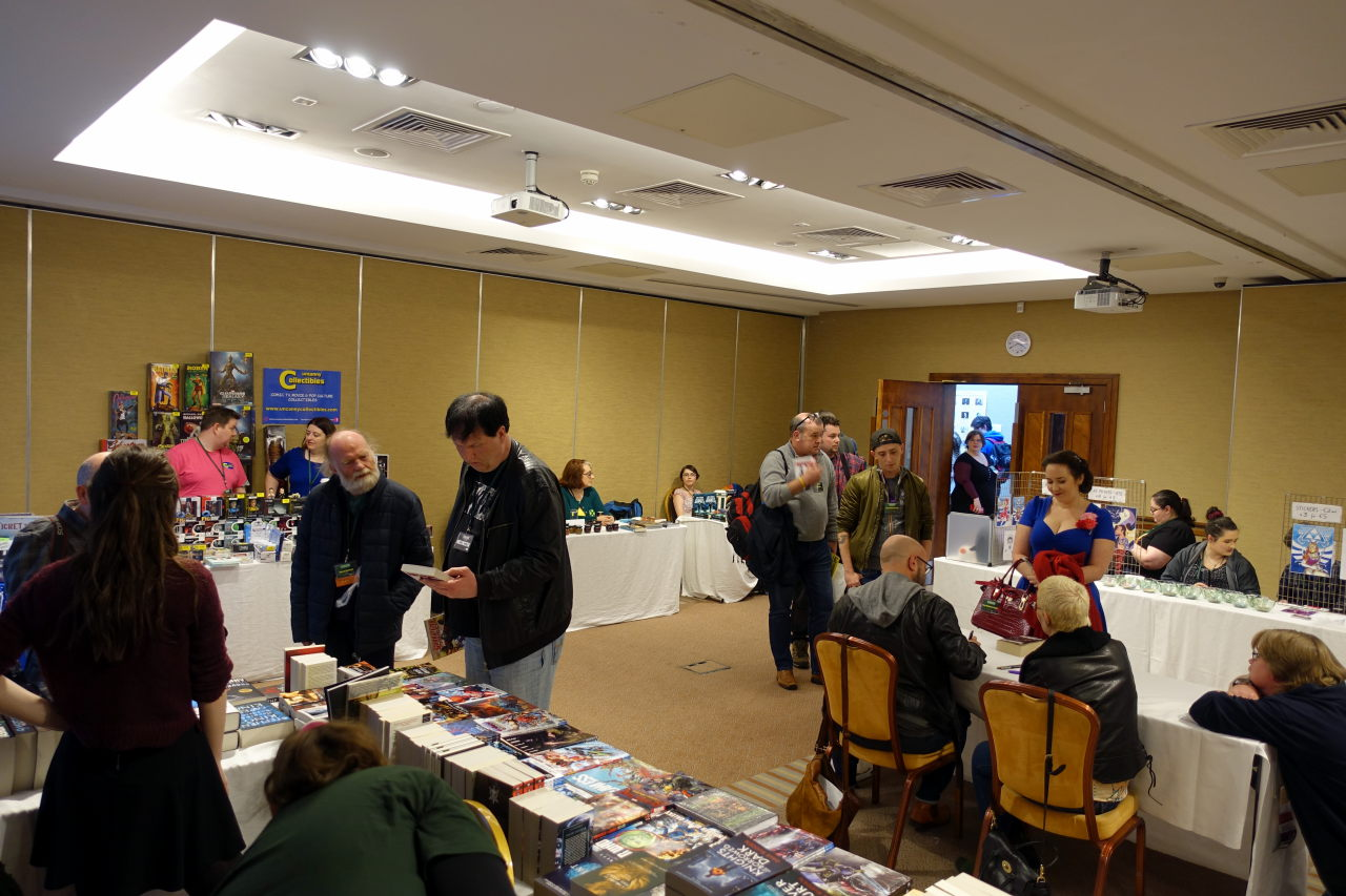 Dealer's room and the table where Octocon's Guests of Honour are signing their works