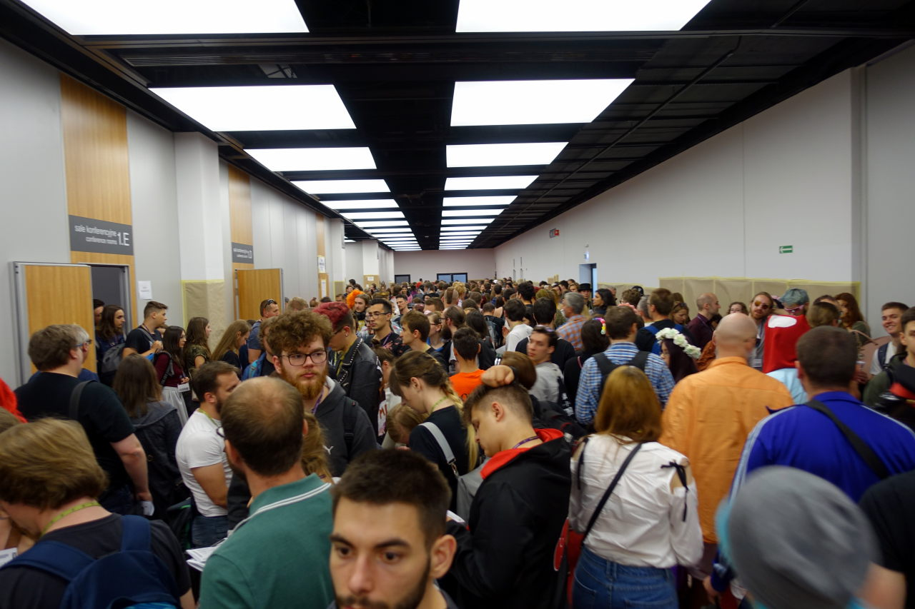 Picture shows a corridor full of people