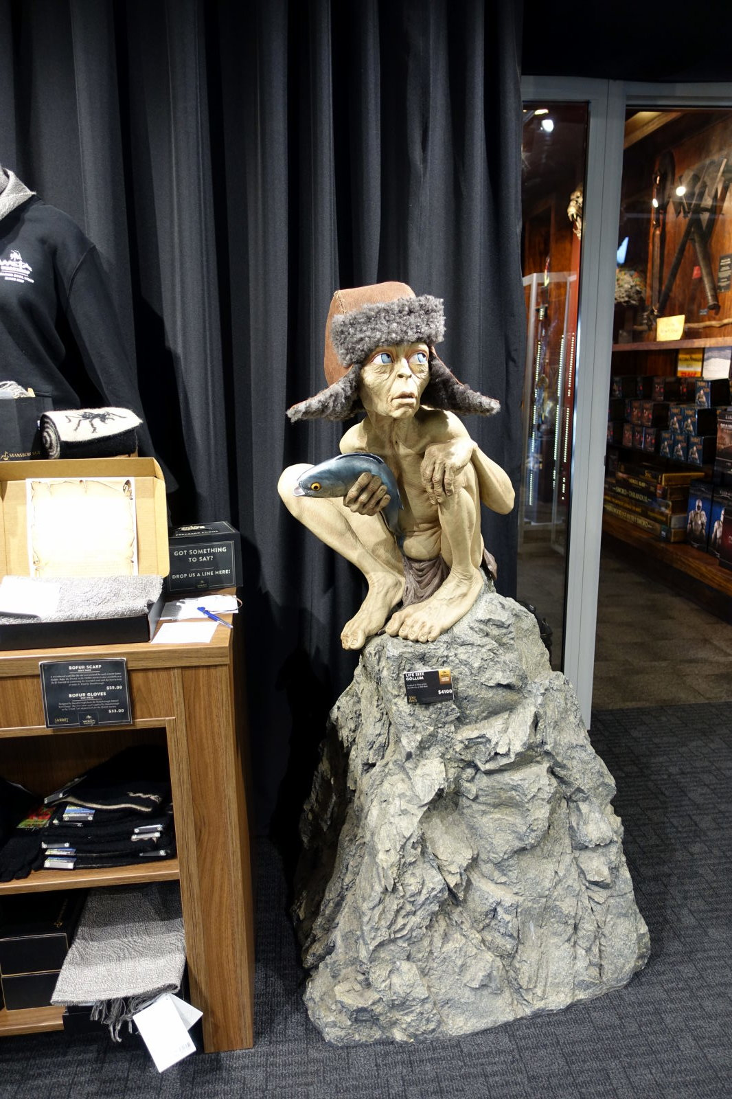 Figure of Gollum on the rock. Gollum wears ushanka.