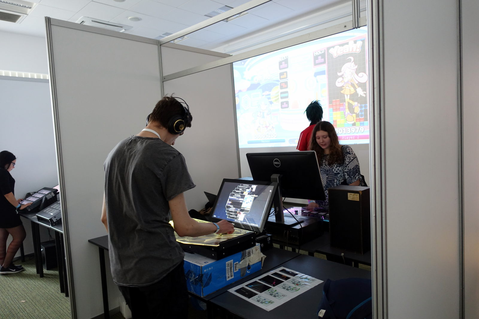 Picture shows people playing music games.