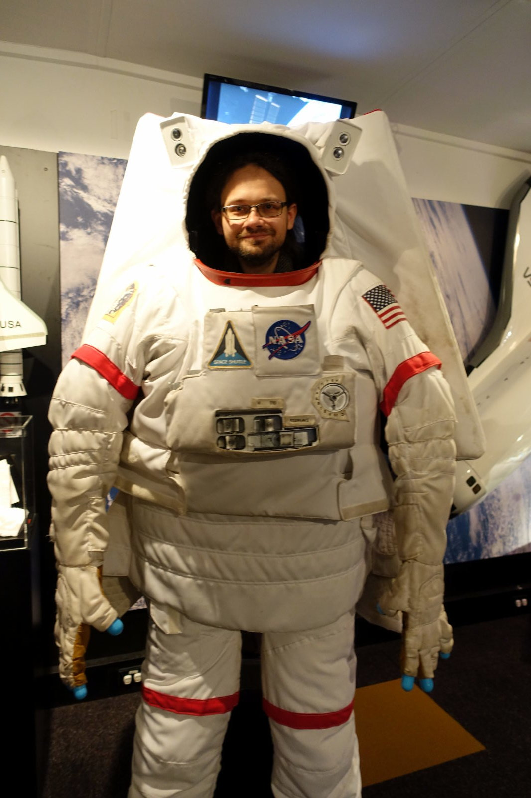 Man posing to the picture in astronaut's suit