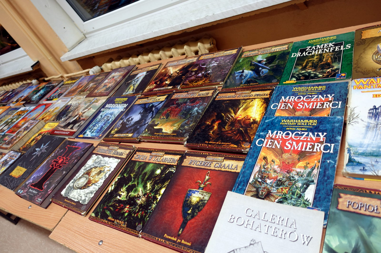 Multiple RPG books presented in three rows.