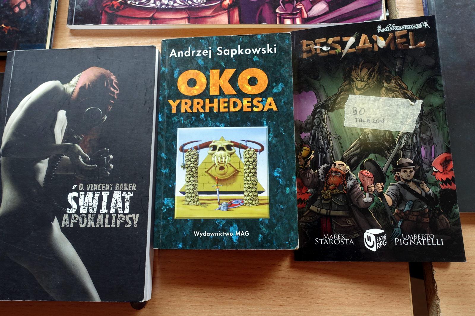 Picture shows three RPG books Świat Apokalipsy (Apocalypse word), Oko Yrrhedesa by Andrzej Sapkowski (Yrrhedes' Eye) and Beszamel (Béchamel).