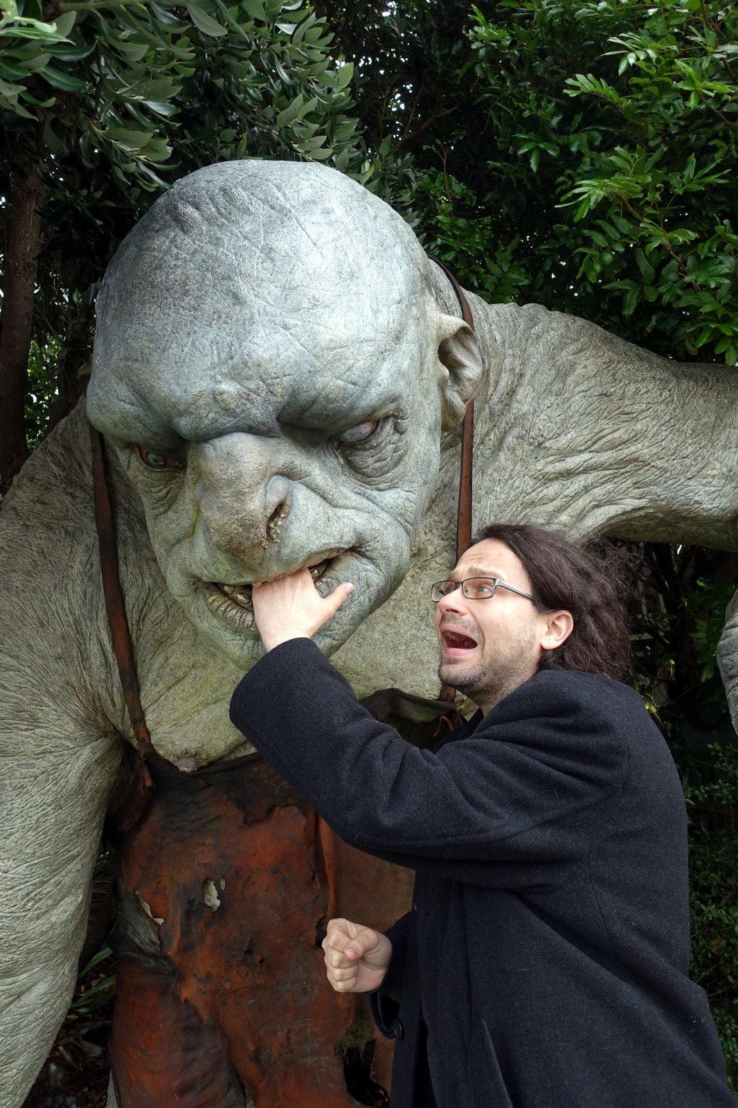 Man screaming while troll figure