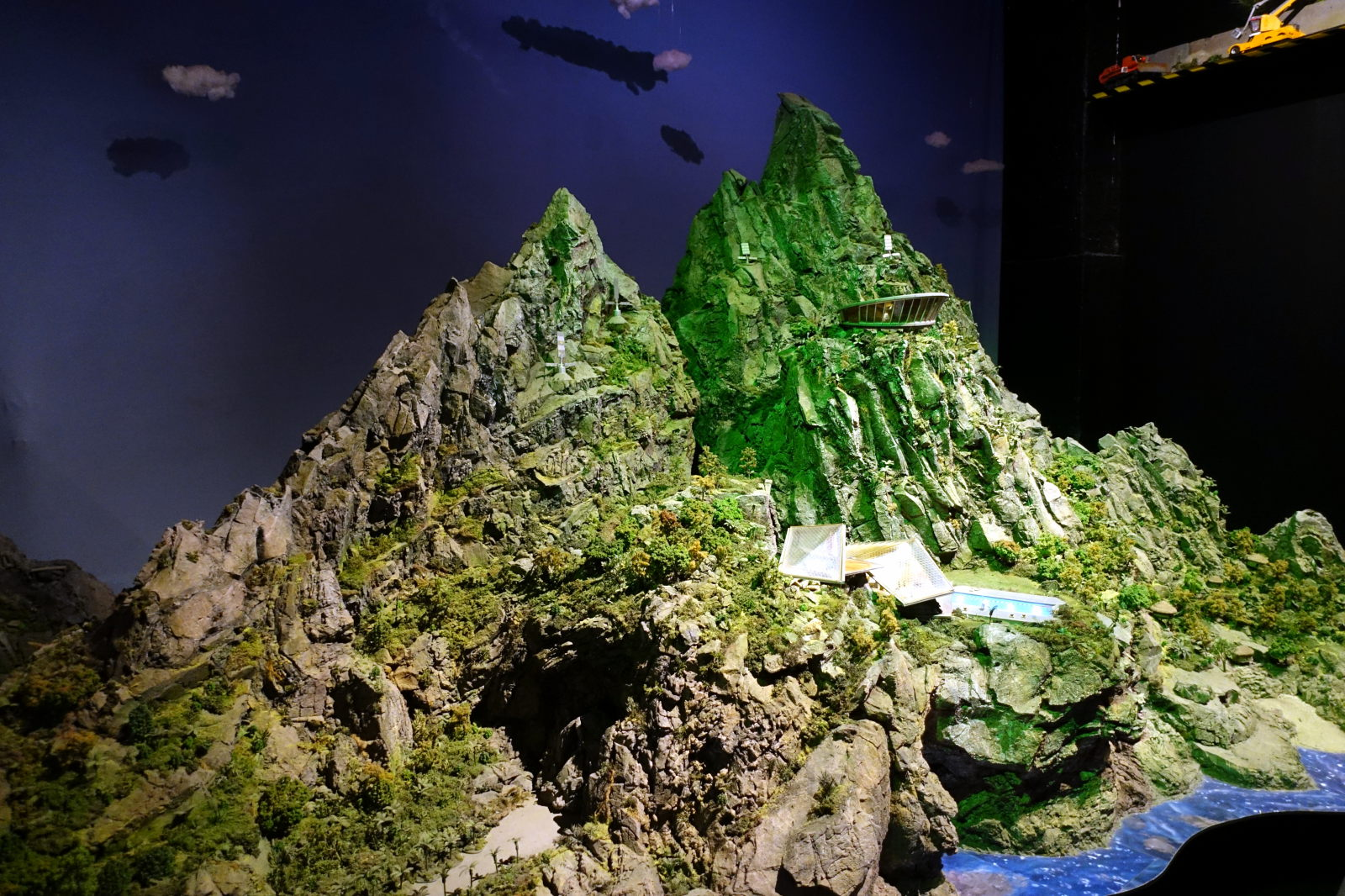 A movie set showing a mountain with green slopes.