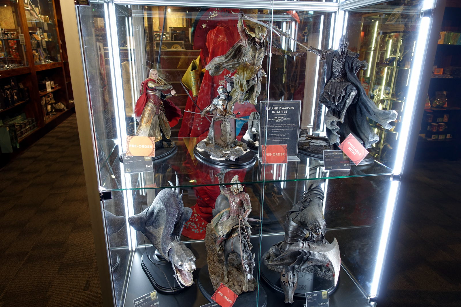 Six LOTR/The Hobbit figures in display case.