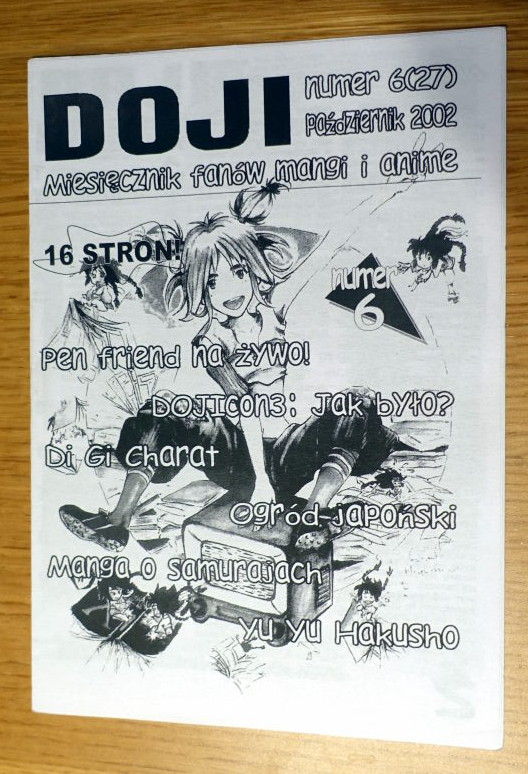 Black and White cover of the magazine. It depicts a girl drawn in manga style.