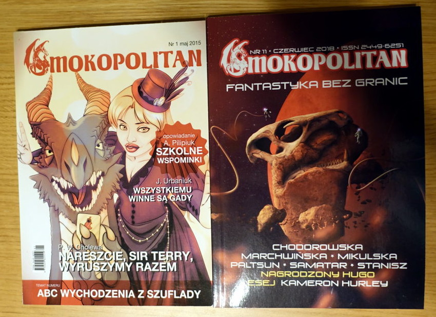 Two covers of 'Smokopolitan' fanzine. The first shows woman taking selfie with dragon. The second shows a big dragon's skull in space with a planet (or moon) behind it.