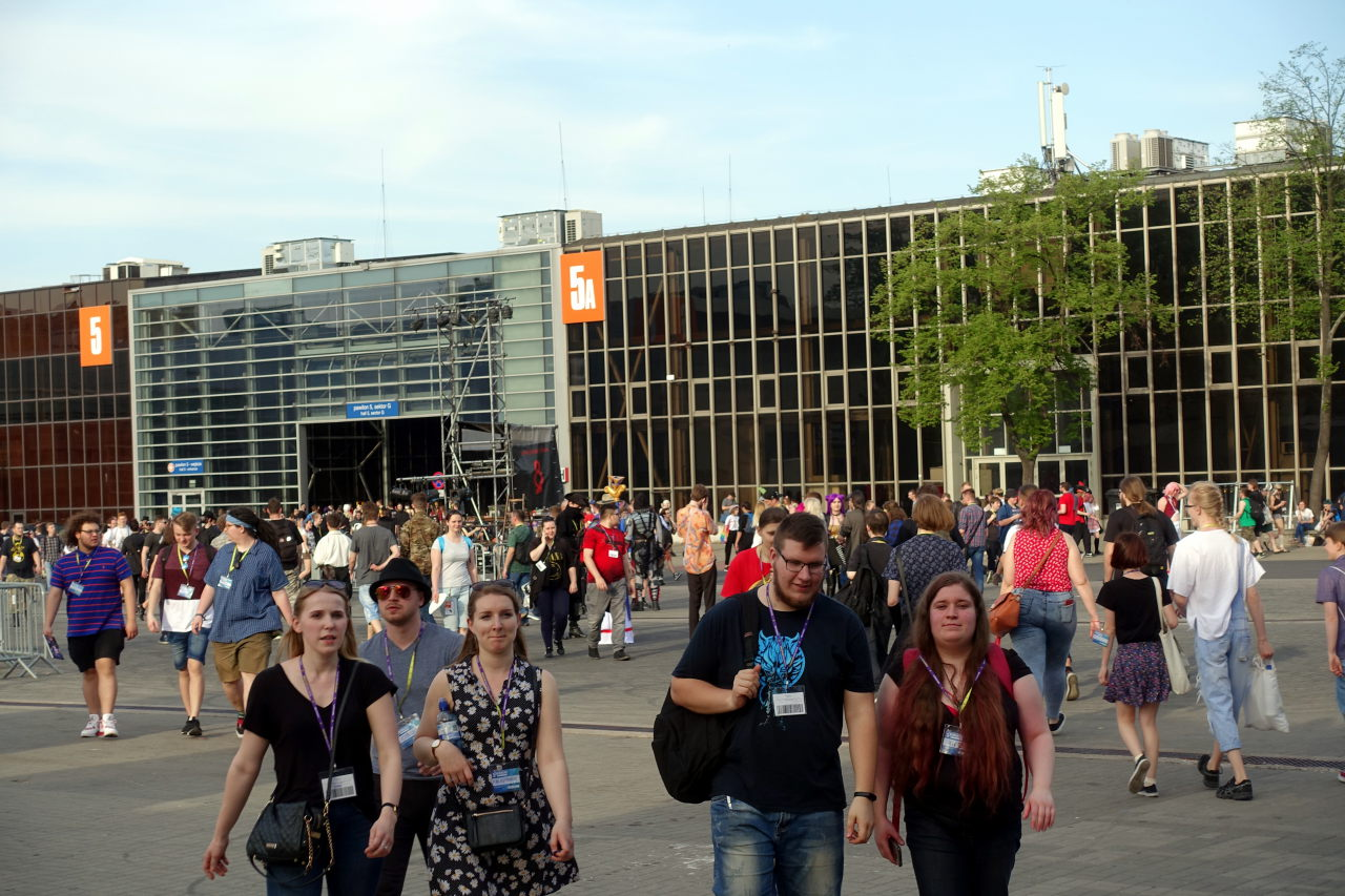 Many people walking from one of the Pyrkon 2019's building to the other.