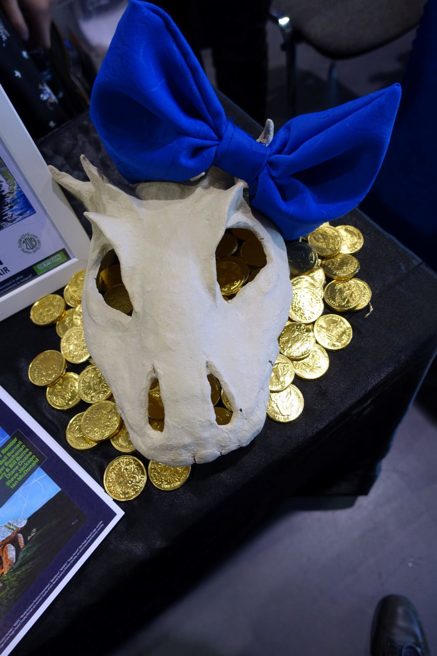 Dragon skull with a ribbon bow on it.
