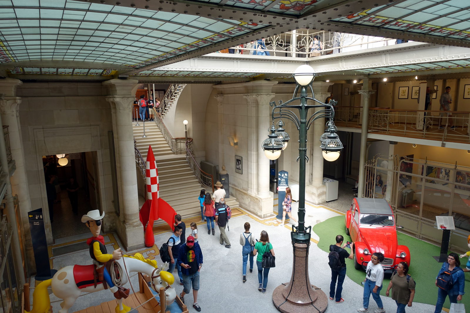 Picture shows interior of the building. A rocket from Tintin and large Lucky Luke on a horse statue are visible.