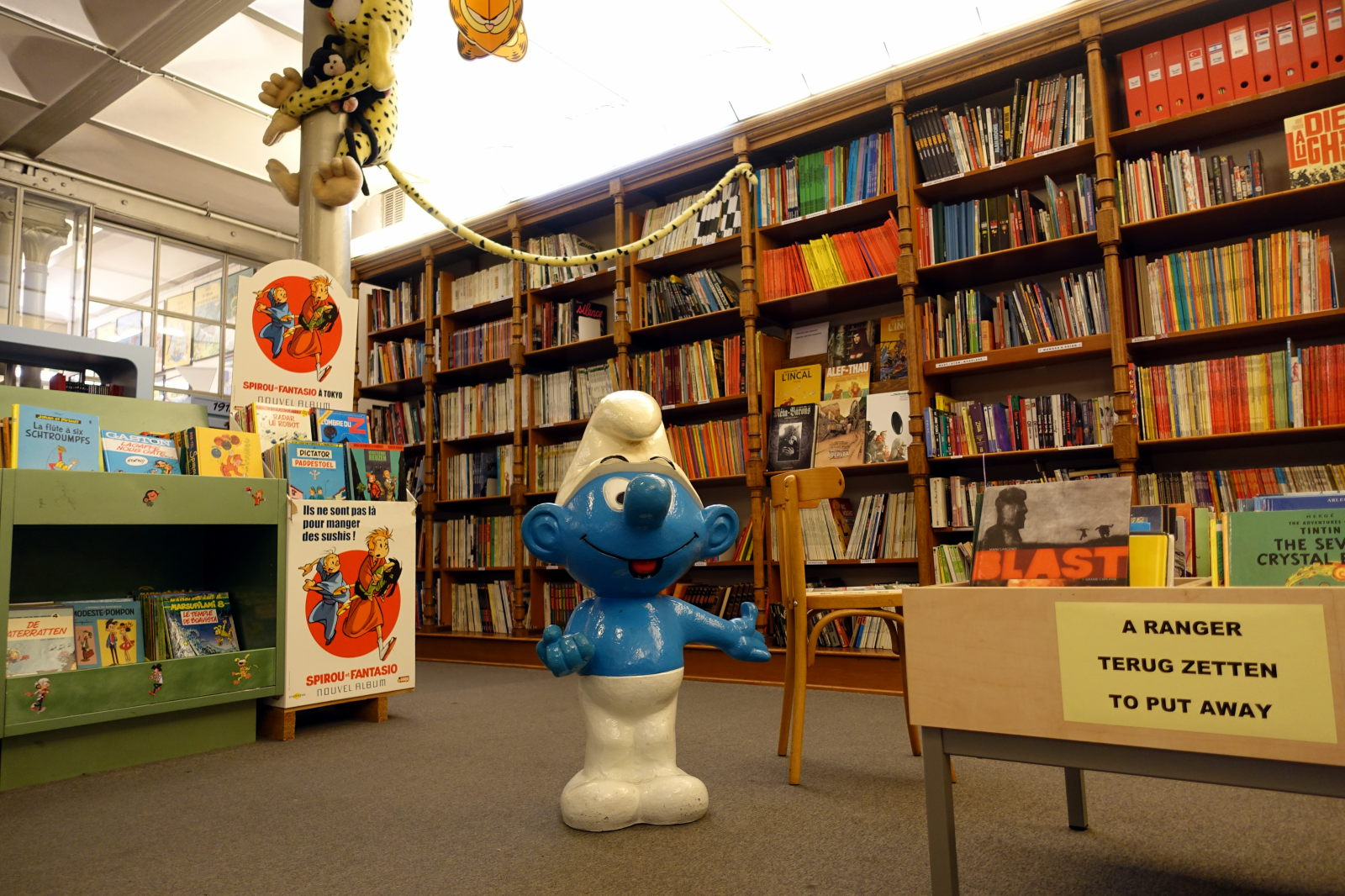 Interior of the library with a Smurf statue.
