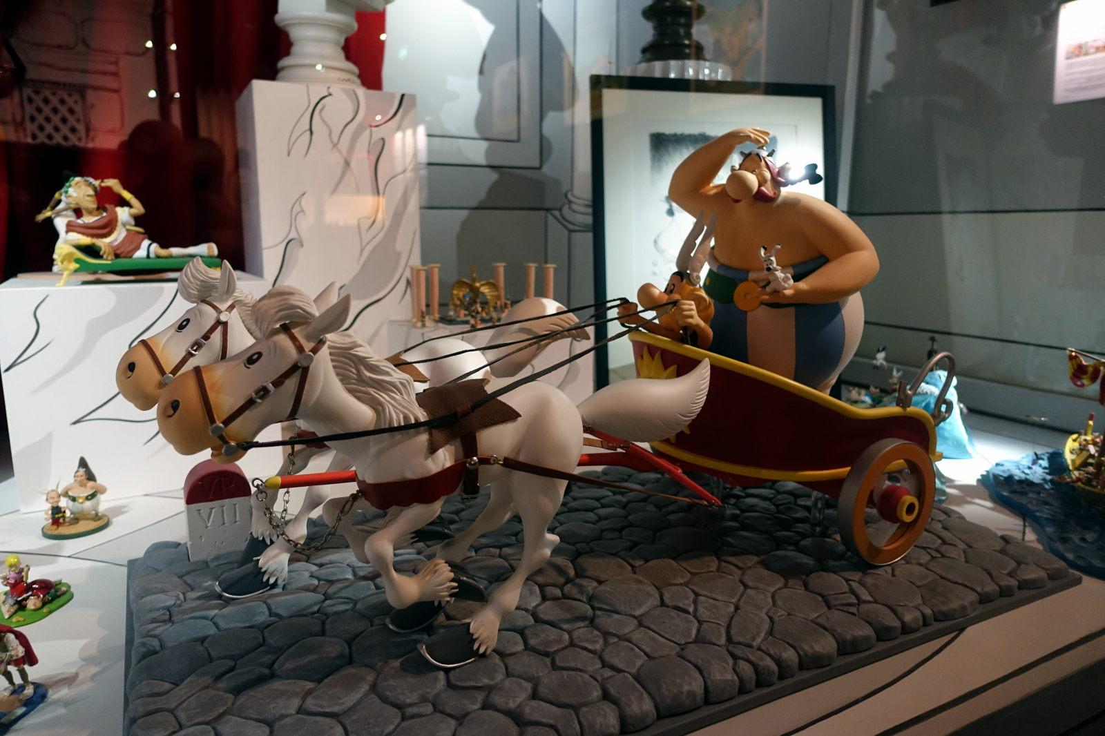 Obelix riding a chariot.