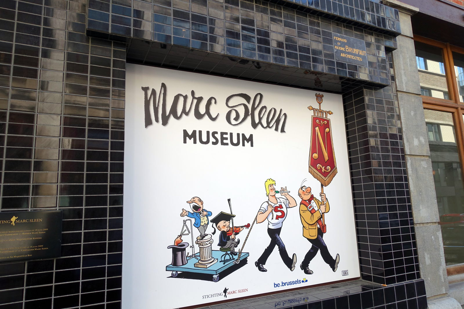Signboard in front of the Marc Sleen Museum. It depicts a few characters from his works.