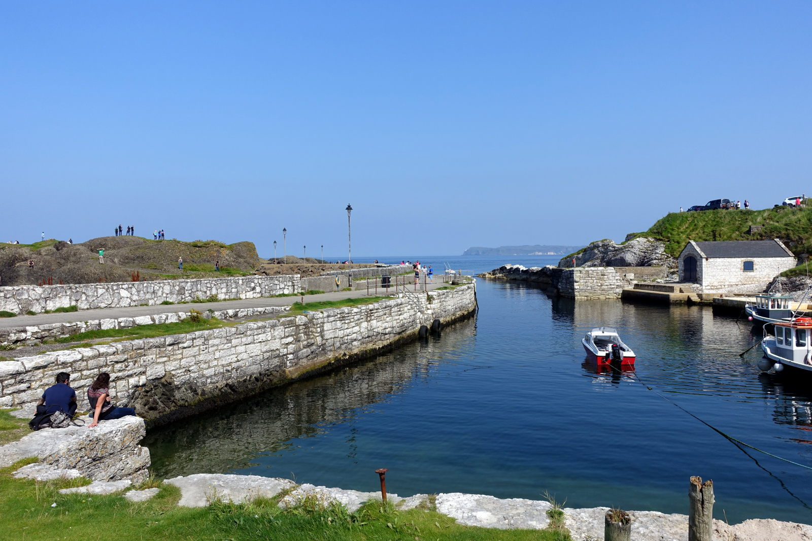 Part of the harbour with stone built wall to the left.