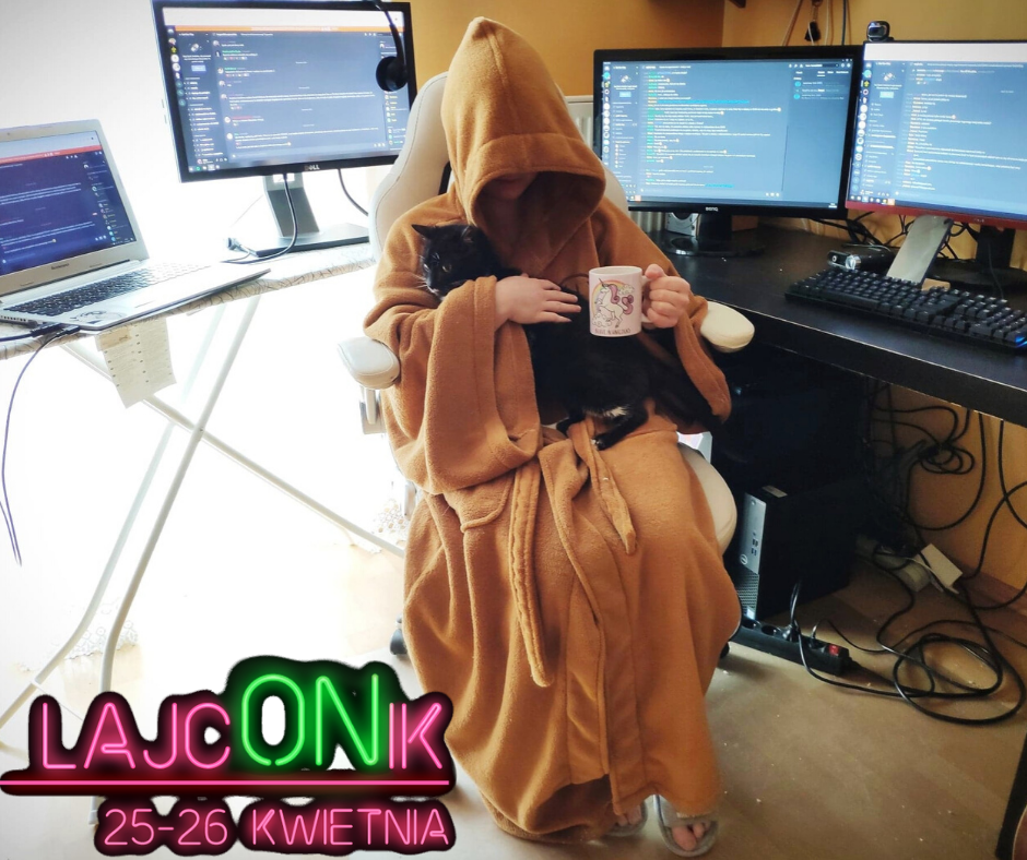 Picture showing person in a robe sitting on a chair.  Face of the person is not visible because of the hood. There is a back cat on the person's knees and a cup in her hand. Behind the person there are three computer screens and a laptop.