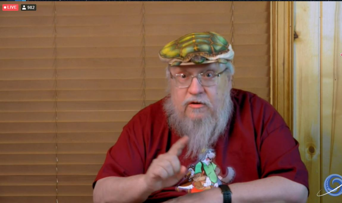 George R.R. Martin with a turtle shaped hat.