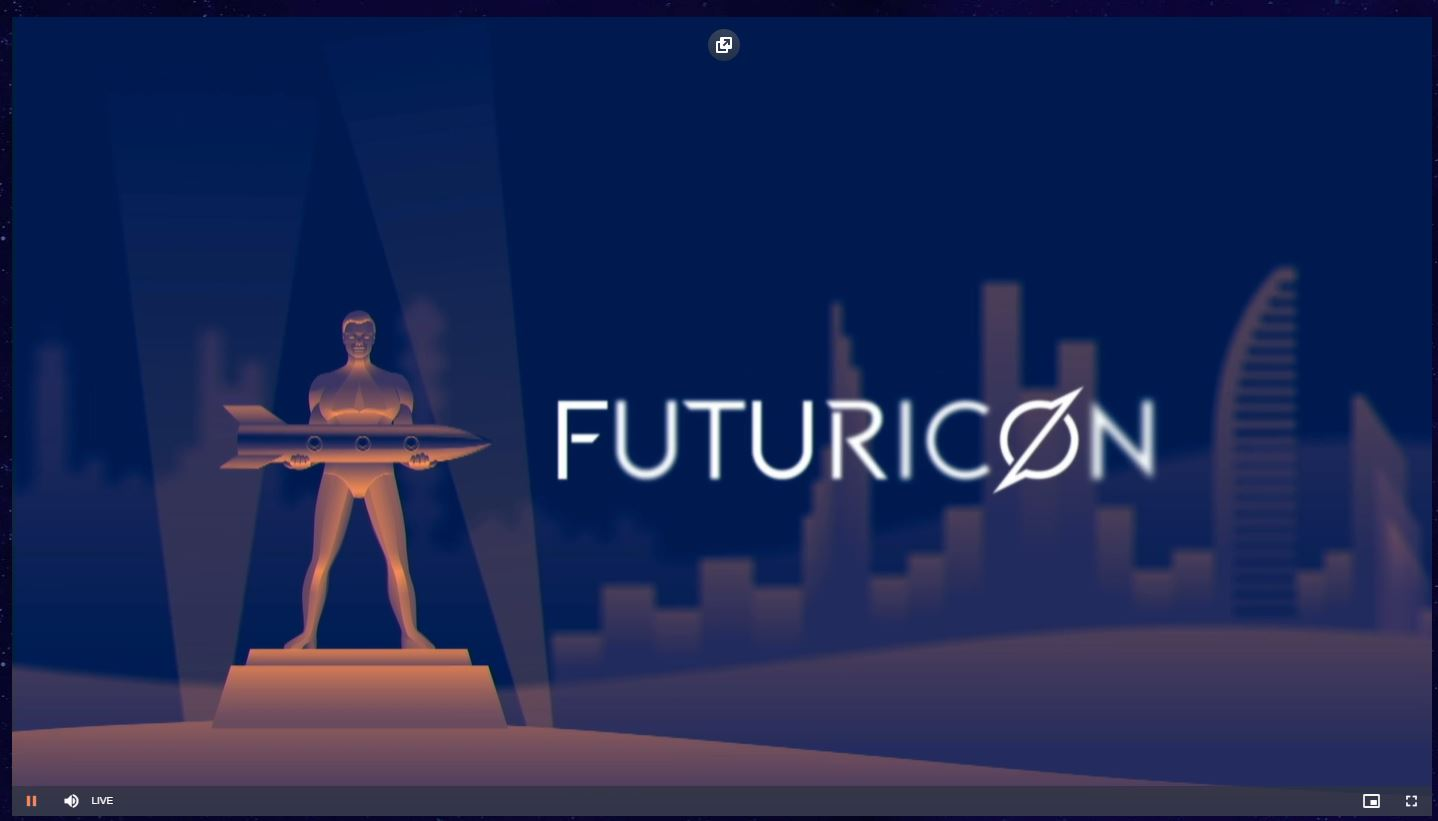 Picture depicts a sculpture of man holding a rocket. Behind there is a skyview of a city. There is also 'Futuricon' text.