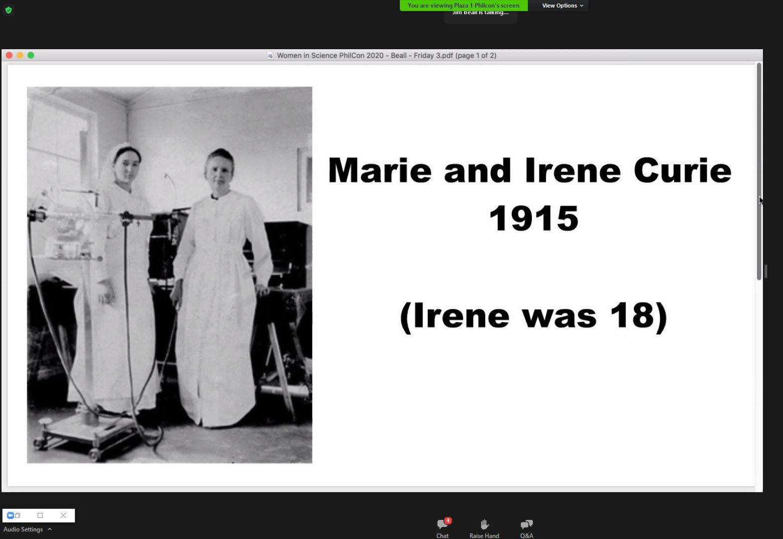 Screenshot from Zoom. It is a slide showing a picture of two women in white lab coats/dresses. Description states: 'Marie and Irene Curie 1915 (Irene was 18)'.