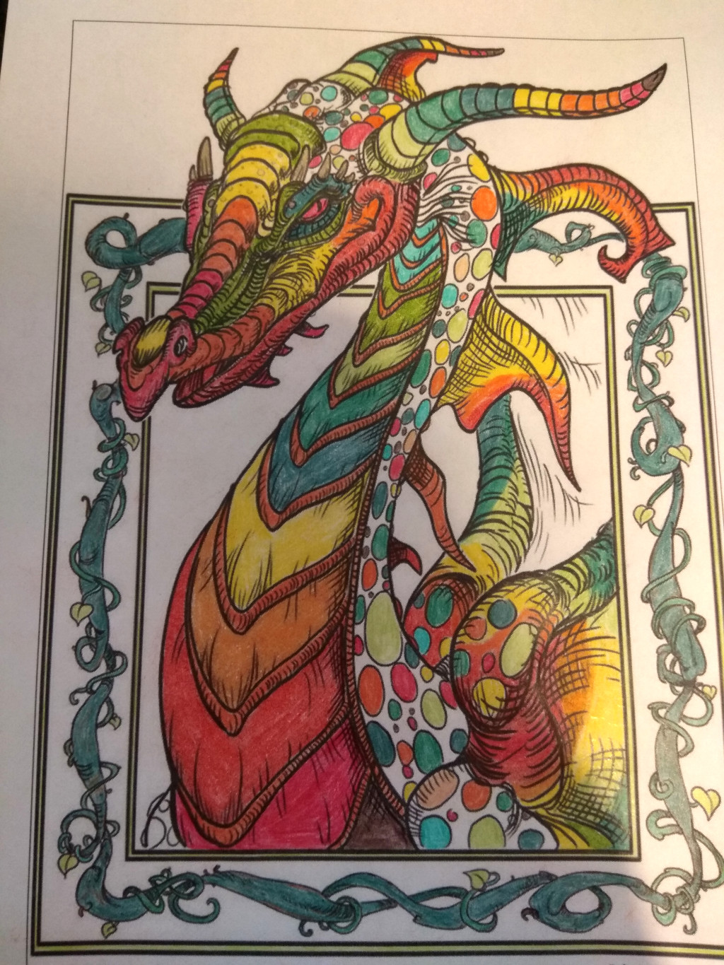 Picture of a dragon. It is colorfull with different shades of red, orange, yellow, and green used.